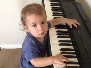George plays piano at Early Learning Music Class