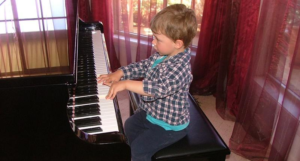 Feature Image Hunter plays grand piano PNG for Music Matters website