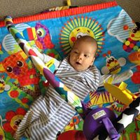 Baby George plays with music mobile Early Learning Music