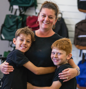 Julie, Cooper and Mitchell share hugs at Music Matters lesson