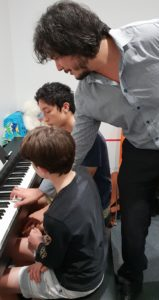 Tim shares Blues Progressions with Daniel and Lucas at Sunshine Coast Kids Gig Bands lesson